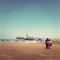 Photo taken at Scheveningse Strand by Sanne G. on 5/13/2012