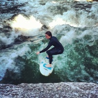 Photo taken at Eisbach Wave by Tarah F. on 7/23/2012