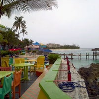 Photo taken at Compass Point Beach Resort by Kate H. on 5/31/2012