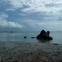 Photo taken at Pantai Romodong by Ronny N. on 5/20/2012
