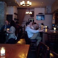 Photo taken at The Tangled Vine Wine Bar & Kitchen by Teresa K. on 6/4/2012