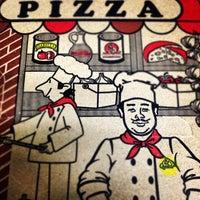 Photo taken at Michelangelo's Pizza by Jansen G. on 3/28/2012