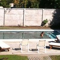 Photo taken at Piscina Donde German Brasil 645 (pucon) by Cristian H. on 2/23/2012