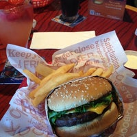 Photo taken at Red Robin Gourmet Burgers by John A. on 7/4/2012