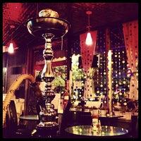 Photo taken at Anatolia Cafe & Hookah Lounge by Cake on 8/8/2012