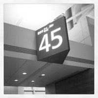 Photo taken at Gate 45 by Louis L. on 4/10/2012