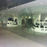 Photo taken at COMME des GARÇONS 青山店 by Ayakka on 4/21/2012