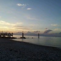 Photo taken at Cedar Beach by Reyhan Ö. on 7/28/2012