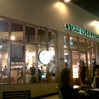 Photo taken at Starbucks Coffee by Christian V. on 8/29/2012