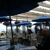 Photo taken at Paradise Cove Beach Cafe by Harrison H. on 6/14/2012