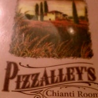 Photo taken at Pizzalley's Pizzeria by Erin P. on 7/26/2012