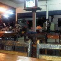 Photo taken at Brutal Cafe by Izzul A. on 3/20/2012