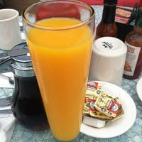 Photo taken at Broken Yolk Cafe by Jessica R. on 7/7/2012