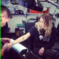 Photo taken at American Beauty Tattoo Parlor by Angie D. on 4/14/2012