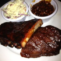 Photo taken at Smokey Bones Bar & Fire Grill by alanEATS on 5/19/2012