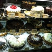 Photo taken at The Cheesecake Factory by Elizabeth on 5/22/2012