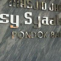 Photo taken at Masjid Jami Asy-Syakirin by Krisna H. on 3/30/2012