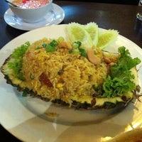 Photo taken at Pormtip Thai Restaurant by Alex l. on 9/11/2012