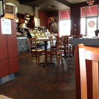 Photo taken at The Grind Coffee House-N-Café by JC T. on 3/23/2012