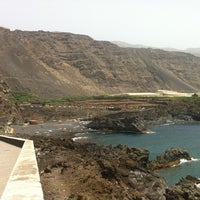Photo taken at Playa de Charco Verde by María C. on 8/11/2012