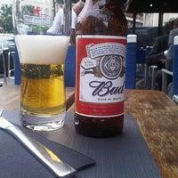 Photo taken at Tropical Café by Michaël T. on 7/19/2012