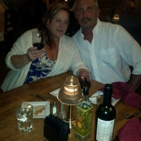 Photo taken at Twin Owls Steakhouse by Pamela S. on 8/5/2012