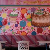 Photo taken at Tajmani's by Lorena T. on 9/11/2012