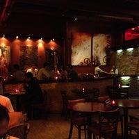 Photo taken at Iguana Café by Owen P. on 5/4/2012