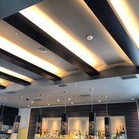 Photo taken at Corso Como Cafe by Chris D. on 2/22/2012