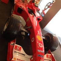 Photo taken at Ferrari Store by Andrei Y. on 7/25/2012
