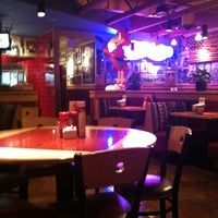 Photo taken at Red Robin Gourmet Burgers by Destini W. on 2/6/2012
