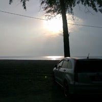 Photo taken at Batu burok beach by Tems33 F. on 9/1/2012