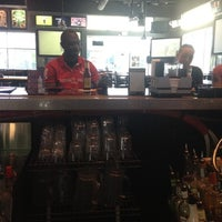 Photo taken at The Hub Sports Bar and Grill by Amanda T. on 4/5/2012