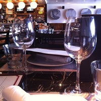 Photo taken at Trattoria Italian Kitchen by Jon Paul J. on 8/16/2012