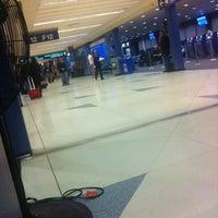 Photo taken at Gate F10 by jaron l. on 2/7/2012