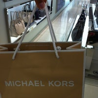Photo taken at Michael Kors by Maria K. on 8/8/2012