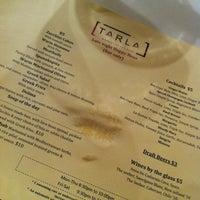 Photo taken at Tarla Mediterranean Bar + Grill by Jerae K. on 7/26/2012