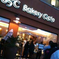 Photo taken at 85°C Bakery Cafe by Julie E. on 3/4/2012