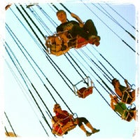 Photo taken at Silly Symphony Swings by Yancey F. on 8/18/2012
