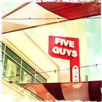 Photo taken at Five Guys by Alexei T. on 7/15/2012