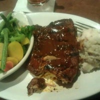 Photo taken at Sporting News Grill by Joseph M. on 3/8/2012