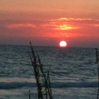Photo taken at Bradenton Beach by Kelly H. on 6/13/2012