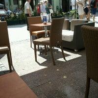 Photo taken at Empik Cafe by Wiktor J. on 6/18/2012