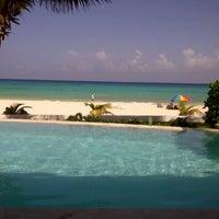 Photo taken at Playa Xaman-Ha by Eugenio B. on 7/29/2012