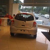 Photo taken at Nissan Grand Brasil by Marco V. on 4/28/2012