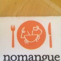 Photo taken at Nomangue by Nathalia S. on 7/14/2012