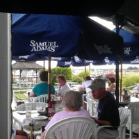 Photo taken at Chelos Waterfront Bar & Grille by Angela S. on 8/20/2012