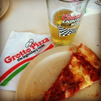 Photo taken at Grotto Pizza by Lauren S. on 8/4/2012