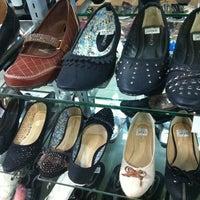 Photo taken at VIP Shoes Warisan Square by EK on 8/14/2012