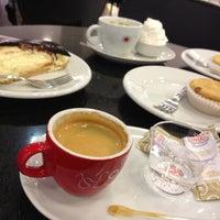 Photo taken at Café Do Ponto by Raquel M. on 7/12/2012